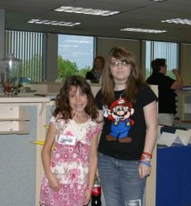 Jessica and a friend at the Prudent Publishing headquarters on Take Your Child to Work Day 2010